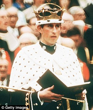 Crowned: Prince Charles looks overawed at his investiture, but he carried it off well with encouragement from the queen