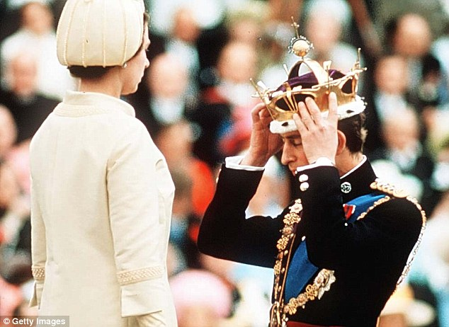 Thats better: Charles adjusts the coronet to his liking after his mother placed it upon his head