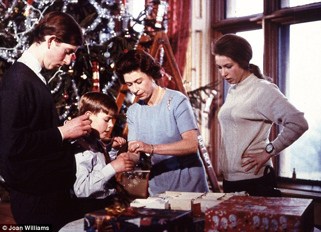 Family Christmas: The Queen helps Andrew open a present watched by Charles and Anne. But look at the size of the tree!