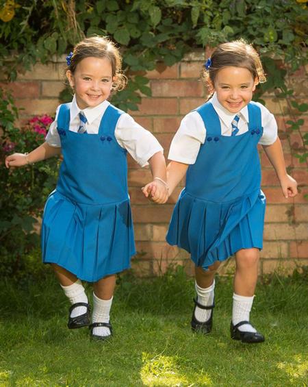 Hai bé Rosie và Ruby Formosa hiện đáng yêu, khỏe mạnh. Ảnh: PA