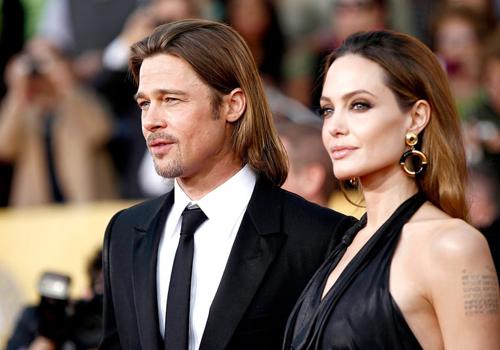 Angelina Jolie muốn nuôi cả 6 con nhưng Brad Pitt không đồng ý. Ảnh: AP.