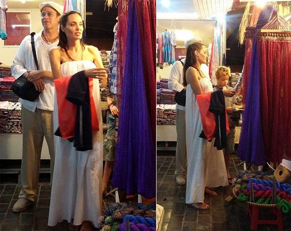 Hình ảnh giản dị như những đôi vợ chồng bình thường của cặp đôi vàng Hollywood tại khu chợ đêm ở Campuchia tháng 12/2015.