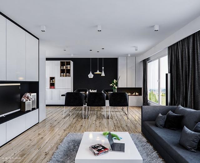 4. Ghế đen kết hợp với bức tường màu đen ở cuối tạo nên 1 không gian sống mở. Một điểm nổi bật là 3 chiếc đèn treo có kiểu dáng vô cùng đặc biệt.