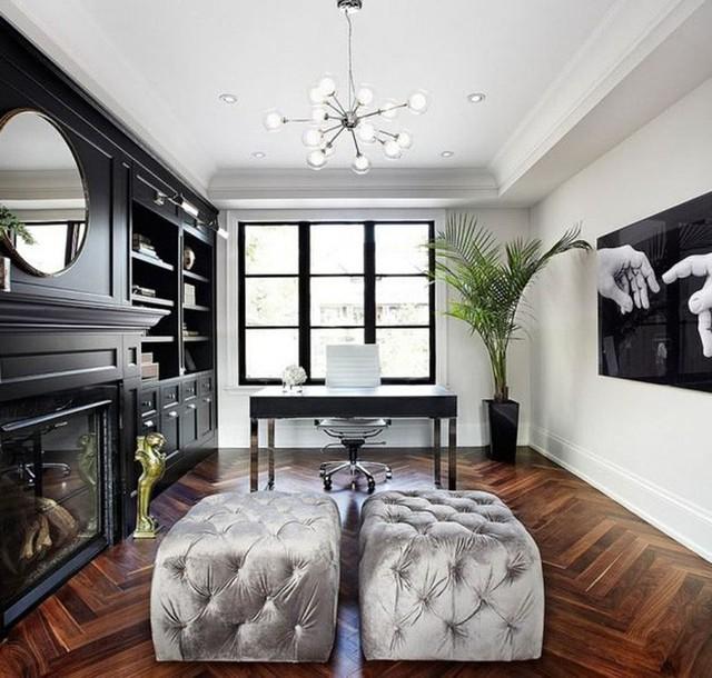 Một căn phòng làm việc được thiết kế với màu đen thể hiện sự chuyên nghiệp, địa vị của chủ nhân.