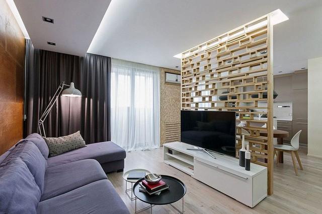 Chất liệu gỗ trong phòng khách không nhất thiết lúc nào cũng phải giới hạn ở trên tường.