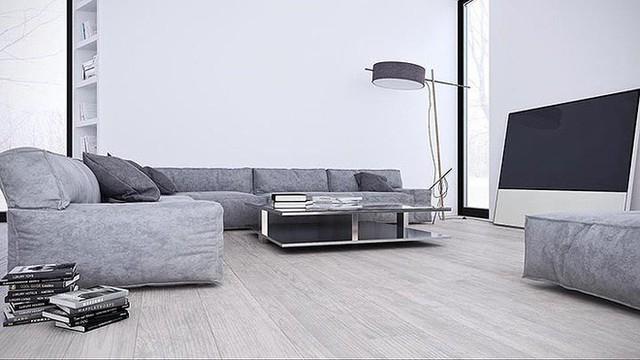 Trong phòng khách của ngôi nhà này, tất cả các bức tường trắng kết hợp với ghế sofa màu xám nhạt cùng với một chiếc đèn cây độc đáo.