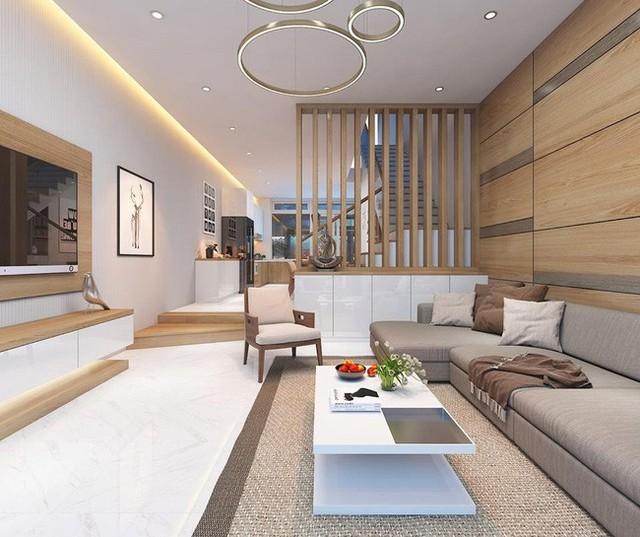 Hệ nan gỗ giúp chia không gian phòng khách với cầu thang.