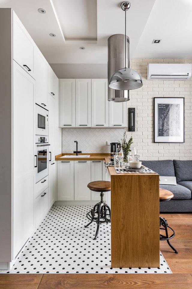 Vỏn vẹn 25m² nhưng căn hộ nhỏ với vẻ ngoài độc đáo vẫn khiến người xem mãn nhãn vì sự kết hợp siêu mượt mà - Ảnh 1.
