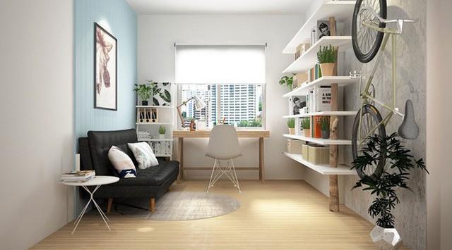 Bàn đặt gần cửa sổ nên căn phòng rất ít khi phải dùng đèn, xe đạp treo tường trở thành tác phẩm trang trí.