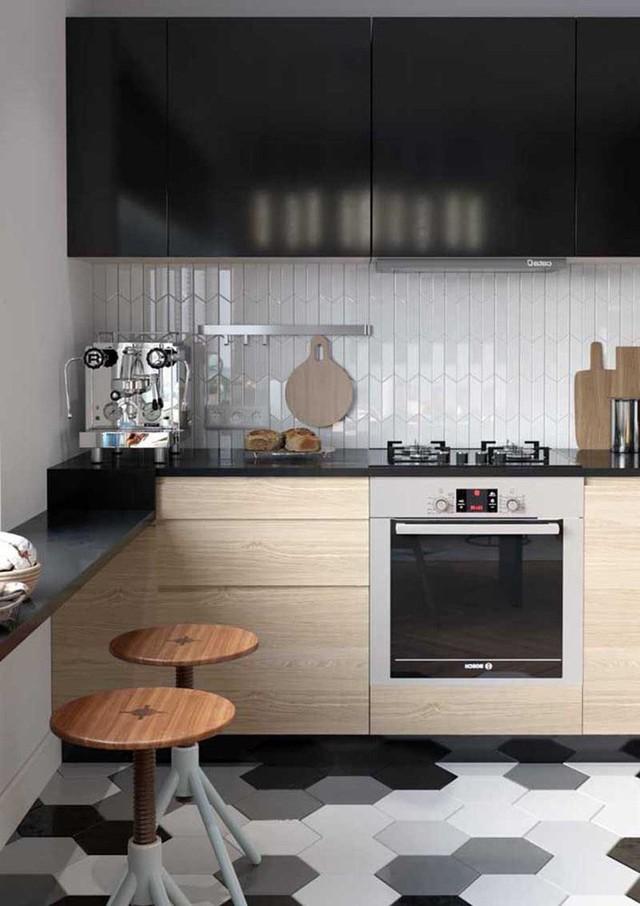Bạn có thể lựa chọn ốp gạch men cho bức tường nhà bếp.