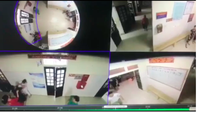 Hình ảnh camera ghi lại chị Phương (áo trắng góc trái màn hình) bị hành hung. Ảnh cắt từ clip