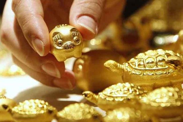 Giá vàng hôm nay 12/2: Tiếp tục vững ở trên đỉnh cao - Ảnh 1.