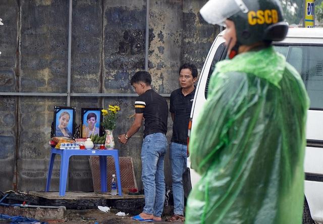 Hai mẹ con nghi bị giết trước khi tiệm cầm đồ cháy - Ảnh 2.