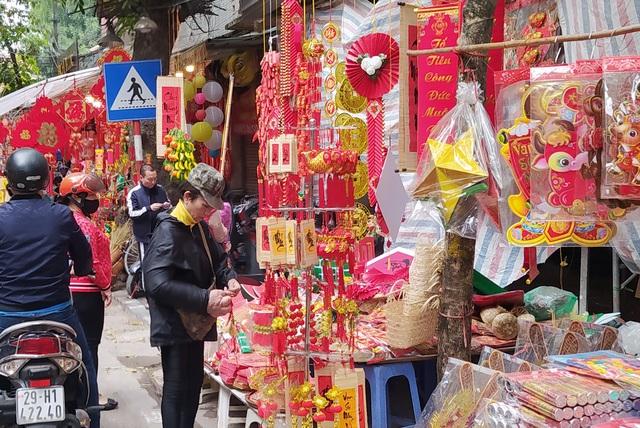 هانوی: شهر Hang Hang در روزهای Tet مشغول است - عکس 7.