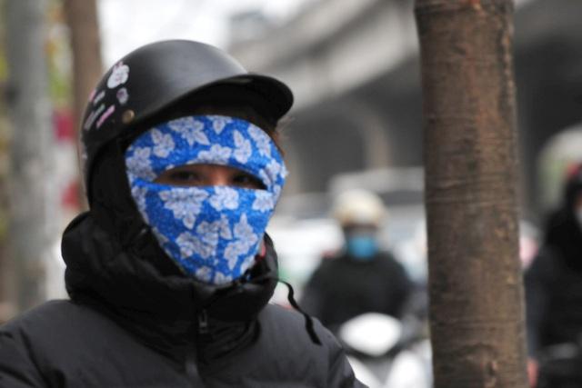 لباس های ویژه هانوی در اولین روز سردترین رکورد - عکس 12.