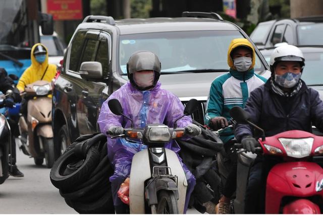 لباس های ویژه هانوی در اولین روز از یک دوره سرد سرد - عکس 9.