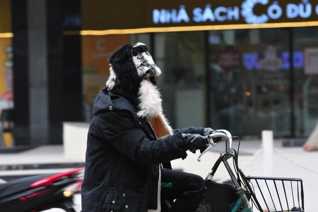لباس های ویژه هانوی در اولین روز ثبت هوای سرد - عکس 1.