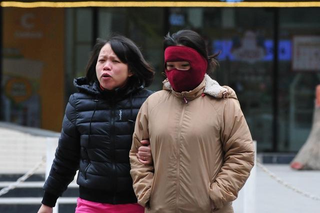 لباس های ویژه هانوی در اولین روز سردترین رکورد - عکس 11.