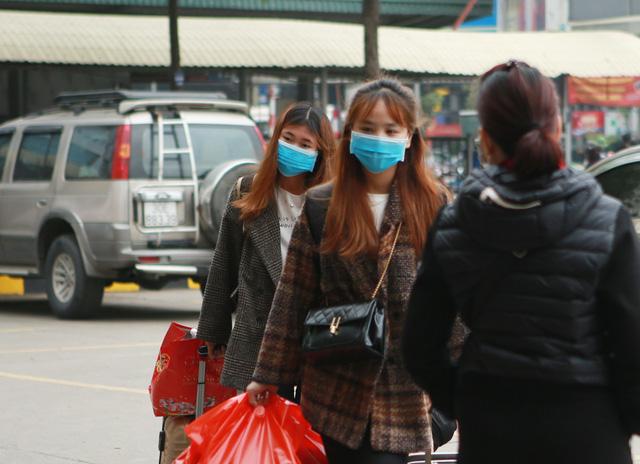 Hà Nội: Bến xe ngày Tết phòng, chống dịch COVID-19 nghiêm ngặt như thế nào? - Ảnh 12.