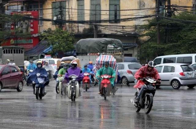 Đón mưa dông giải nhiệt, Hà Nội mát lịm sáng đầu tuần - Ảnh 1.