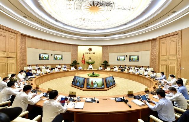 Thủ tướng Phạm Minh Chính: Chống dịch từ phòng ngự sang chủ động tấn công - Ảnh 3.