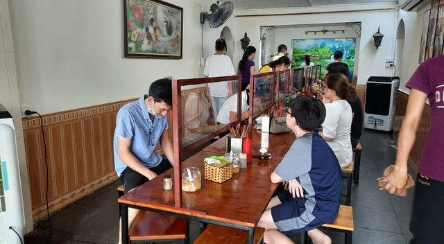 Hà Nội: Quán cà phê, ăn sáng hồ hởi đón khách sau chuỗi ngày tạm đóng cửa - Ảnh 5.