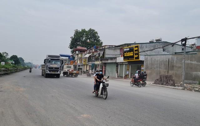 Hà Nội phê duyệt điều chỉnh thời gian thực hiện Dự án mở rộng QL1A đoạn qua huyện Thường Tín - Ảnh 1.