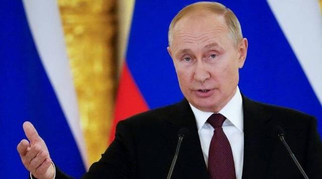 Tổng thống Putin tự cách ly vì tiếp xúc người mắc Covid-19 - Ảnh 2.