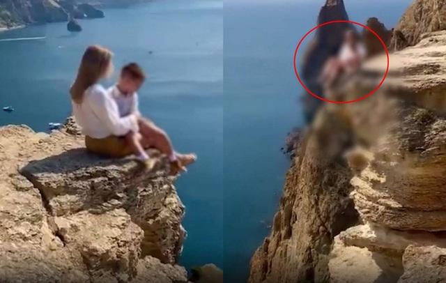Mẹ đưa con trai lên vách đá chụp ảnh sống ảo, dân mạng phát hiện chi tiết chết người, đòi tước quyền làm mẹ ngay - Ảnh 3.