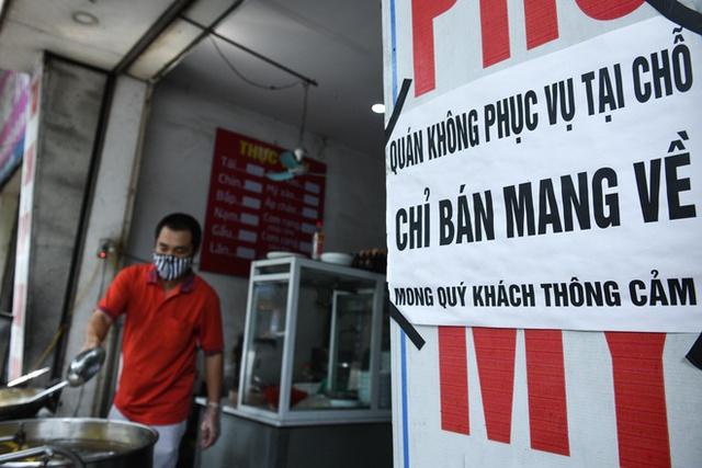 Từ sáng 21/9: Hà Nội cho phép mở lại cửa hàng cắt tóc, gội đầu, vẫn bán hàng ăn mang về - Ảnh 1.