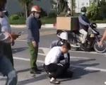Xác minh clip người mặc đồ công an 'chỉ gọi điện thoại' ở hiện trường vụ bắt cướp ở Hà Nội