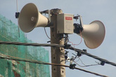 Không có chuyện đài truyền thanh quận bị chèn sóng tiếng Trung Quốc