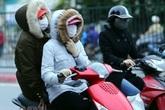 Thời tiết ngày 12/1: Người dân Hà Nội chịu rét đậm rét hại đi sắm Tết