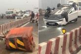 Ô tô tông vào dải phân cách, lật ngửa trên cầu Vĩnh Tuy do nữ tài xế điều khiển