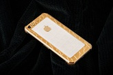 iPhone 5S mạ vàng bọc da cá sấu giá 35 triệu ở VN