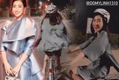 """Hoa hậu nào """"chơi trội"""" như Đỗ Mỹ Linh, diện váy lụa mỏng manh vẫn đi đạp xe"""