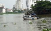 Mẹ chết lặng đứng ngóng tin con mất tích dưới sông Sài Gòn