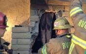Khỏa thân đột nhập vào nhà chồng cũ bị kẹt trong ống khói