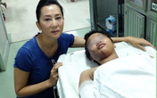 MC Kỳ Duyên chụp ảnh bên bé 12 tuổi bị mẹ đốt vì không bán hết vé số
