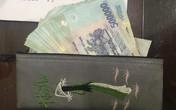 Treo túi trước xe máy, cô gái trẻ suýt mất 30 triệu đồng