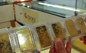 Vàng SJC đắt hơn thế giới 100.000 đồng mỗi lượng
