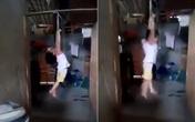 Cháu bé bị cột tay treo lơ lửng trên xà nhà đã được người thân đón về Phú Thọ