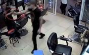 Nổ súng, gây thương tích cho chủ tiệm cắt tóc vì mâu thuẫn tình ái