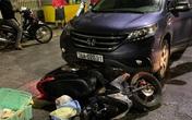 Xe máy chở phụ nữ mang thai bị ôtô kéo lê 500 m