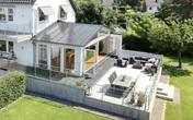 Ngôi nhà màu trắng mang nắng ngập tràn được thiết kế theo phong cách Bắc Âu nổi bật bên vườn cây xanh mát