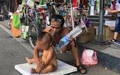Sức khỏe bé 18 tháng tuổi trần truồng ngồi trên thùng xốp mưu sinh giữa trưa nắng Hà Nội hiện giờ ra sao?