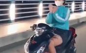 Lộ danh tính cô gái đi xe máy thả 2 tay múa quạt gây bức xúc dư luận
