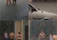 Hoảng hốt với hình ảnh cặp đôi mặc bikini lội giữa phố sau cơn mưa
