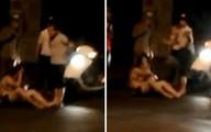 Chồng đá liên tiếp vào mặt vợ gây náo loạn trên đường Minh Khai