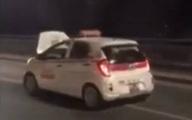 """Taxi bung nắp ca-pô vẫn """"đánh võng"""" trên cầu Nhật Tân"""